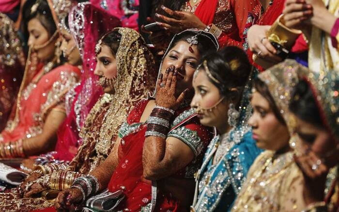 Muslim brides wait for the start of their mass marriage ceremony in Mumbai. (Reuters)