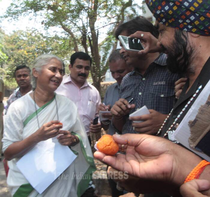 BJP party workers offer ladoos to AAP candidate Medha Patkar. (Source: Express photo by Kevin D'Souza)