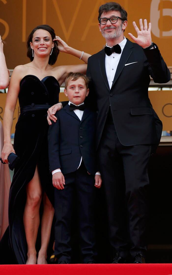 Director of 'The Search' Michel Hazanavicius along with his cast members - Berenice Bejo and Abdul Khalim Mamutsiev pose at the top of the stairs. (Source: Reuters)