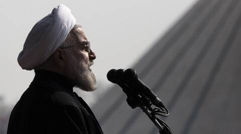 Iranian President Hassan Rouhani, delivers a speech during an annual rally commemorating anniversary of the 1979 Islamic revolution, at the Azadi 'Freedom' Square in Tehran, Iran. (AP)