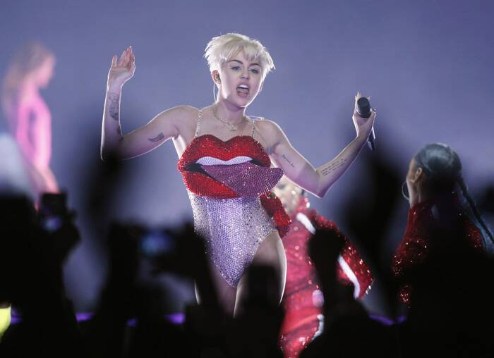 Miley Cyrus set the crowd rocking as she danced to the pumping beats in a sequined bodysuit featuring a gigantic tongue coming out of the lips that formed the upper part of the bizarre outfit. (Reuters)