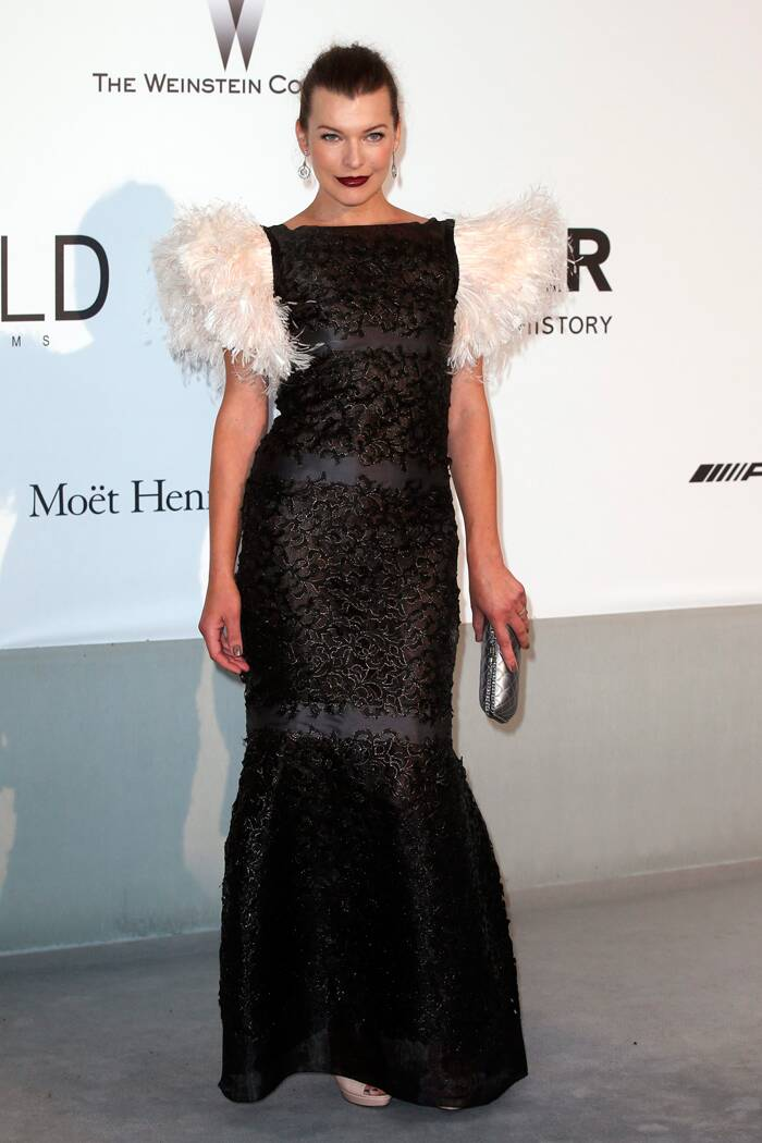 Milla Jovovic was edgy in a black and white feathered number. (Source: Reuters)