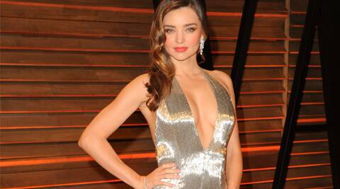 Miranda Kerr has revealed that she distributes most of her clothes.