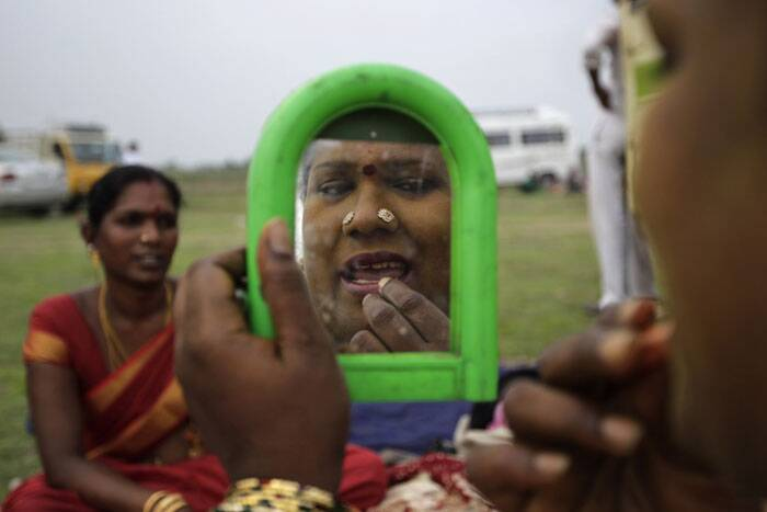 Eunuchs dress up during the annual eunuch festival in Koovagam, in Tamil Nadu on Tuesday.<br /> Eunuchs from all over India gather in this village to re-enact a story adopted from Mahabharata, in which they symbolically marry Aravan, believed to be the patron god of transgender communities. (AP)