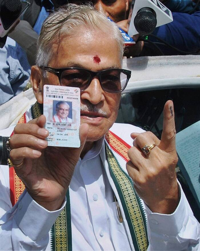 Brisk voting was recorded in most of the 41 constituencies in three  states during last phase of Lok Sabha polls in which the spotlight is on the high-profile contest in Varanasi where a controversy broke out over the Congress candidate sporting the party symbol. <br /><br /> Senior BJP Leader M M Joshi shows his inked finger after casting his vote for the last phase of Lok Sabha election in Varanasi on Monday. (PTI) Senior BJP Leader M M Joshi shows his inked finger after casting his vote for the last phase of Lok Sabha election in Varanasi on Monday. (PTI)