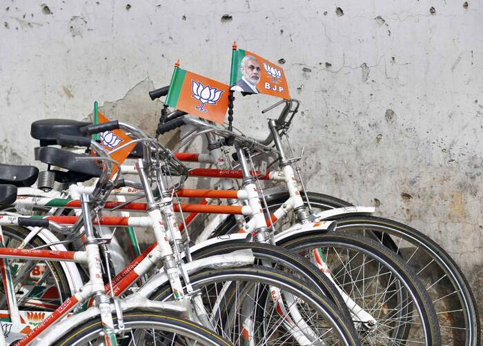 The ruling Congress-led UPA was tipped to get between 101 and 148 seats while 'others', including regional parties and Left, were projected to get between 146 and 156 seats, according to the polls shown on TV channels at the end of the ninth and last phase of Lok Sabha polls.<br />Bicycles decorated with BJP flags and an image Narendra Modi are parked inside the BJP headquarters in New Delhi.  (Source: Reuters)