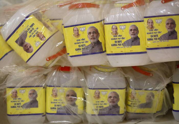 Modi could become India's next prime minister, four major exit polls showed on Monday, with his opposition party and its allies forecast to sweep to a parliamentary majority in the world's biggest ever election. <br />Plastic jars with images of Narendra Modi and party's president Rajnath Singh are seen stacked atop of each other at the party's office in New Delhi. (Source: Reuters)