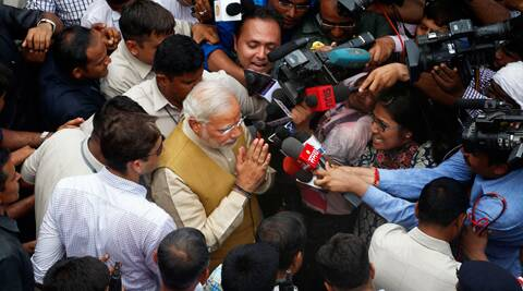 Narendra Modi greets supporters as he leaves the residence of his mother in Gandhinagar. (Source: AP photo)