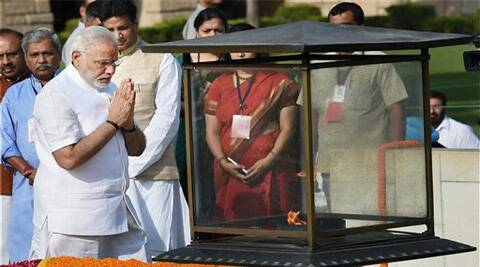 Prime Minister-designate Narendra Modi pays his respects at Rajghat, the memorial of Mahatma GandhI. (Source: AP photo)