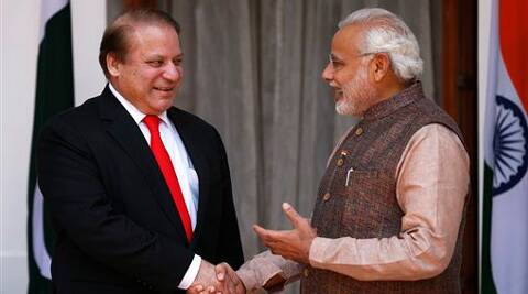 Indian Prime Minister Narendra Modi, right, shakes hand with his Pakistani counterpart Nawaz Sharif before the start of their meeting in New Delhi, Tuesday. (Source: AP photo)