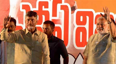 BJP's Prime Ministerial candidate Narendra Modi and TDP President N. Chandrababu Naidu wave to the crowd at a public meeting in Tirupati late on Wednesday night. (PTI)