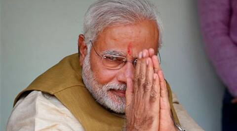 Narendra Modi greets supporters during preliminary results on Friday. (Source: AP)