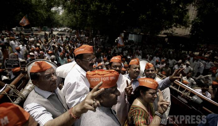 BJP workers led by leaders Venkaiah Naidu, Mukhtar Abbas Naqvi and Ravi Shankar Prasad took out a protest march from Delhi BJP office to the headquarters of the Election Commission. (IE Photo: Praveen Khanna)