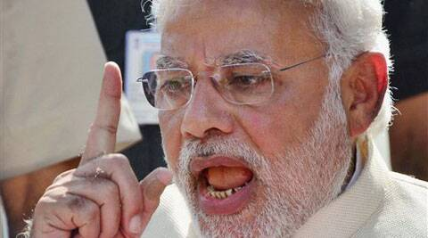 BJP PM candidate and Gujarat Chief Minister Narendra Modi addresses the media after casting his vote at a polling station during Lok Sabha polls in Ahmedabad on Wednesday. (PTI)