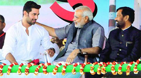 BJP PM candidate Narendra Modi with Ramvilas Paswan and son Chirag. (Express Photo: Ravi S Sahani)