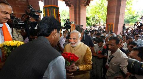 India's next prime minister Narendra Modi, center, is received with flowers as he arrives for the BJP parliamentary party meeting in New Delhi on Tuesday. (Source: AP)