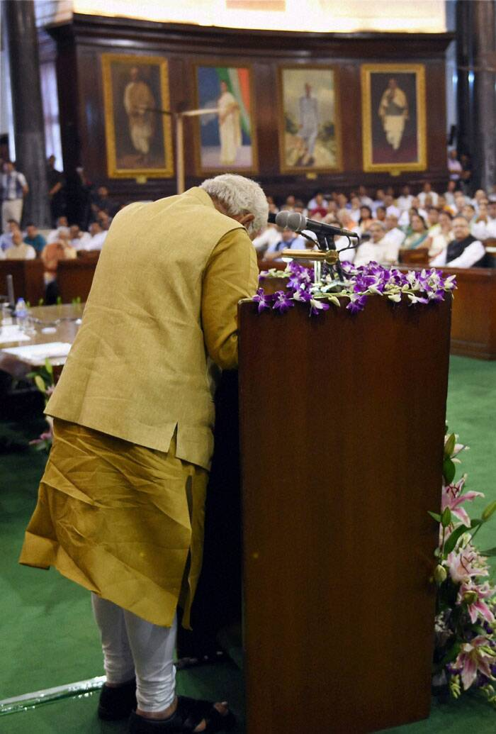 Narendra Modi, generally perceived as a 'strong' leader, turned emotional and broke down on Tuesday as he welcomed his election as the leader of the BJP Parliamentary Party. He choked and had to take water before regaining his posture. (Source: PTI)