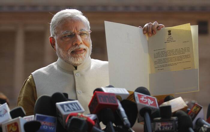 """I came to call on the President. The President has given me a formal letter (of appointment as the PM) and has invited me for oath-taking ceremony on May 26 at 6 pm as we had earlier decided,"" Modi told the media emerging from the meeting with the President Pranab Mukherjee. (Source: PTI)"