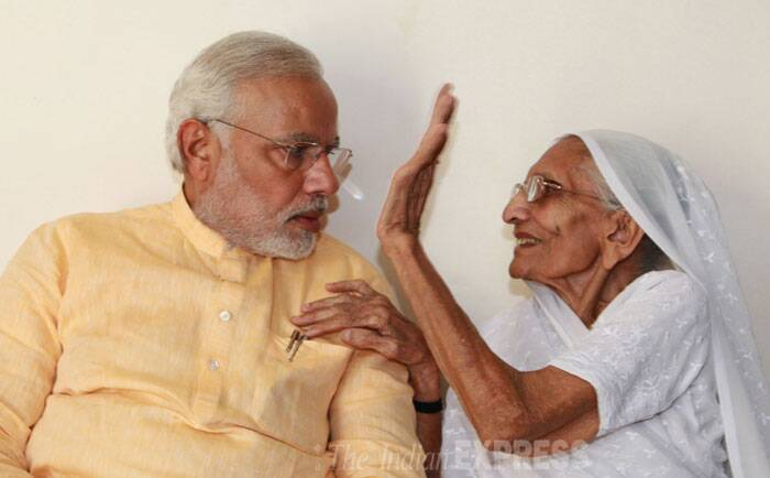 """Gujarat is our family. When I am leaving for Delhi, as per our tradition, I would like to say 'Aavjo' to 6.25 crore people ...'Aavjo Gujarat (goodbye Gujarat),"" Modi said at the airport before leaving for New Delhi. <br /> Prime Minister-designate Narendra Modi is blessed by his mother Hiraba at her residence in Gandhinagar on Thursday. (Source: Express photo by Javed Raja)"
