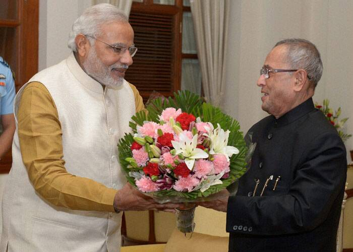 Narendra Modi, who steered BJP and the NDA to a landslide victory in the Lok Sabha elections, was appointed Prime Minister, ushering in a new era of a non-Congress government with an absolute majority on its own  in 30 years. <br /> President Pranab Mukherjee is greeted by Narendra Modi, Leader of the BJP Parliamentary Party, at a meeting at Rashtrapati Bhavan in New Delhi on Tuesday. (Source: PTI)