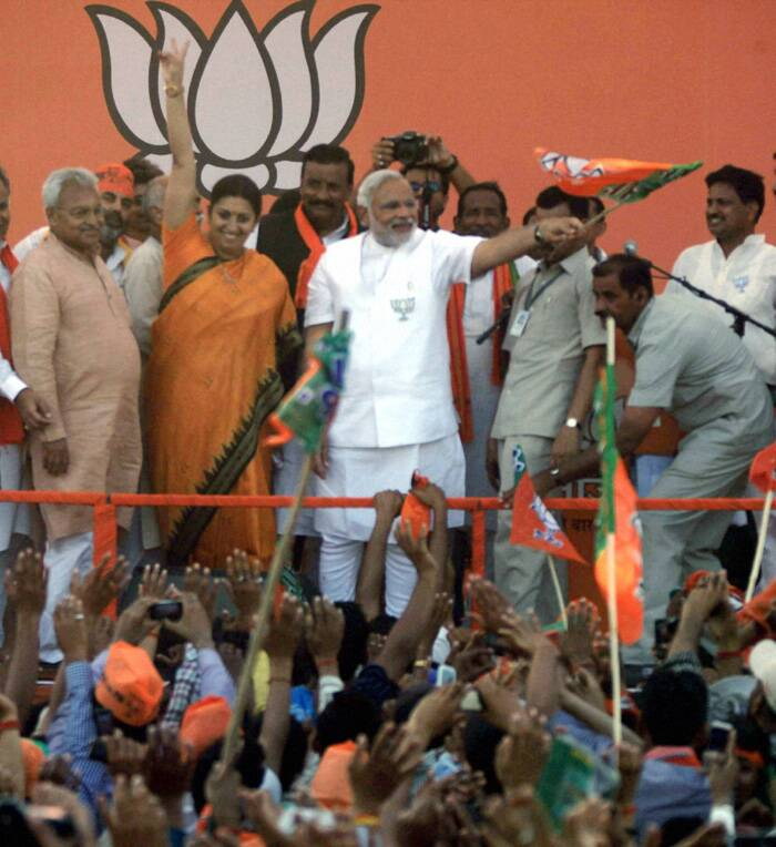 "Breaking an unwritten code, Narendra Modi on Monday (May 5) held a rally in Amethi, in the Gandhi family pocketborough, attacking ""family"" politics but said he has not come for ""revenge"" but for ""change"" in this backward region.<br />The campaigning by Modi in Rahul's constituency was significant as no top leader usually undertakes electioneering in the constituency of top rivals. (PTI)"