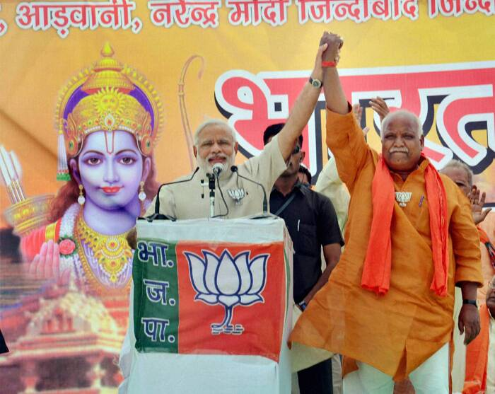 Modi addressed a rally in Faizabad in support of party candidate Lallu Singh from a stage which had pictures of Lord Ram and the proposed Ram Temple model in Ayodhya. (PTI)