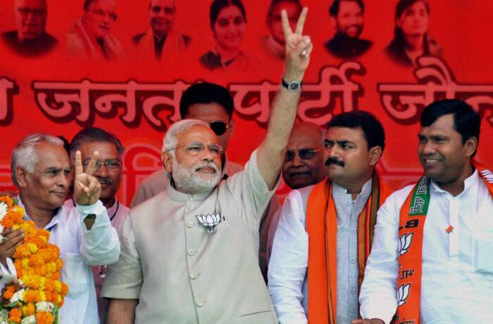 Modi had earlier courted trouble when he was booked for violating electoral laws after he delivered a politically charged speech and displayed his party's symbol 'lotus' soon after voting in Gandhinagar on April 30. (PTI)