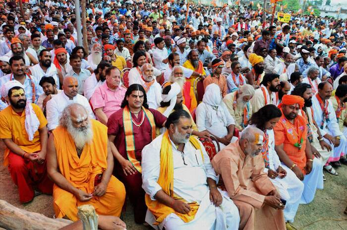 Sadhus and other supporters at Narendra Modi's election campaign rally. (PTI)