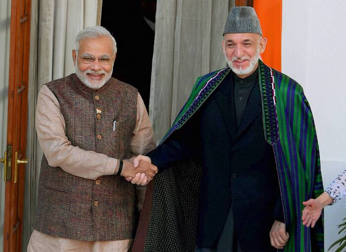 Prime Minister Narendra Modi shakes hands with Afghan President Hamid Karzai during a meeting at Hyderabad House in New Delhi. (Source: PTI)