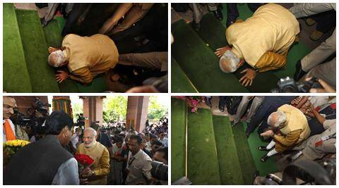 Narendra Modi bends down on his knees on the steps of the Parliament as a sign of respect as he arrives for the BJP Parliamentary party meeting.