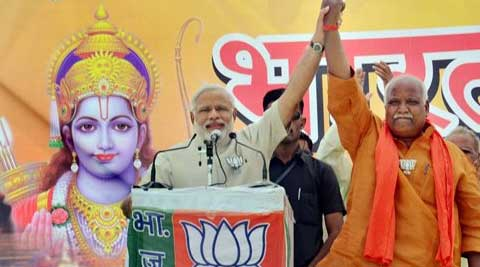 Narendra Modi addressed a rally in Faizabad with the portrait of Lord Ram providing the backdrop. (PTI Photo)