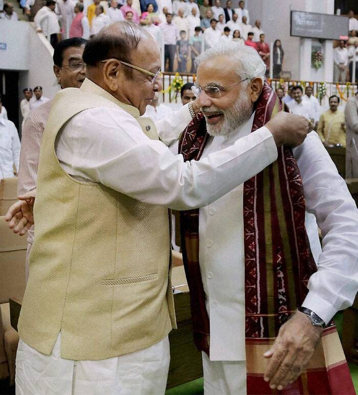 "Narendra Modi fought back tears again as he wished Gujarat to ""surge ahead"" after his departure from the state and sought forgiveness if he had done ""anything wrong"". <br /> Prime Minister-elect and Gujarat Chief Minister Narendra Modi is presented a shawl by senior Congress leader Shankersinh Vaghela during the special session of the state Assembly in Gandhinagar on Wednesday. The special session of the Assembly was called to bid farewell to Modi. (Source: PTI)"