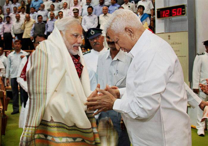 Prime Minister-elect and Gujarat Chief Minister Narendra Modi is greeted by Speaker Vaju Vala during the special session of the state Assembly in Gandhinagar on Wednesday. (Source: PTI)