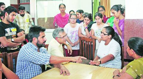 SOPU members argue with the staff of the Girls' hostel in Sector 24 on Thursday. (Source: Express photo by Sumit Malhotra)