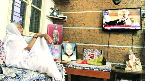 Modi's mother Hiraba watches the swearing-in ceremony, in Gandhinagar. ( Express photo by Bhavesh Ravat )