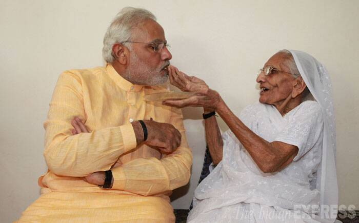 """Aavjo(goodbye) Gujarat"". This was how Narendra Modi bid adieu on Thursday to his home state of Gujarat where he was the four-time Chief Minister since assuming office on October 7, 2001. <br /> Prime Minister-designate Narendra Modi is blessed by his mother at her residence in Gandhinagar on Thursday. (Source: Express photo by Javed Raja)"