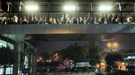 Commuters stranded outside Indraprastha Metro station on Wednesday after a snag disrupted the services. (Oinam Anand)