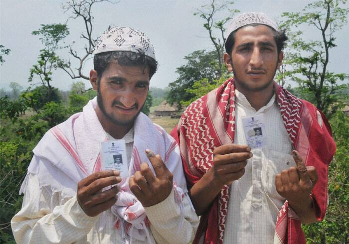 Muslim youths show their inked fingers after casting votes for Lok Sabha poll in Pauri on Wednesday. (PTI)