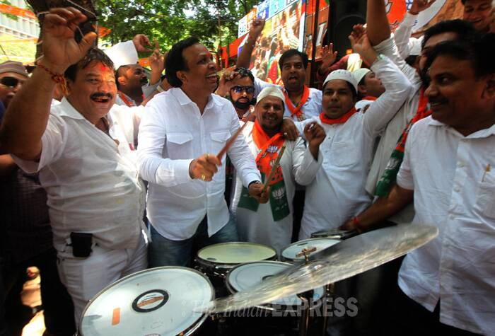 Buoyed by the early trends indicating a rout for Congress across the country and also in Maharashtra, the BJP workers today broke into celebrations at the state party office here in South Mumbai. (Source: Express photo by Prashant Nadkar)