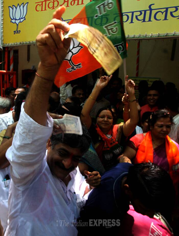 Shouting slogans like 'desh ka PM kaisa ho, Narendra Modi jaisa ho...har har Modi...Ghar Ghar Modi', the party activists also distributed laddoos to each other. (Source: Express photo by Prashant Nadkar)