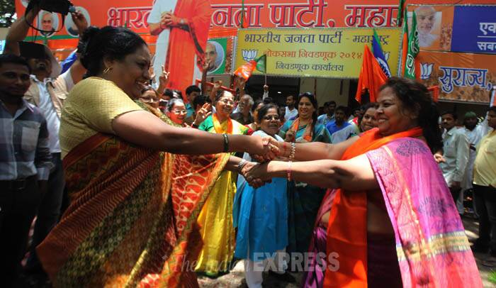 BJP party workers dance during the celebration. (Source: Express photo by Prashant Nadkar)