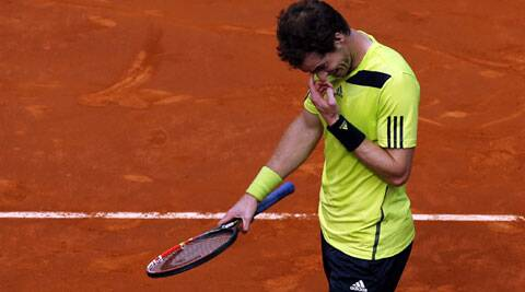 After beating Spain's Almagro in three sets, Murray couldn't carry his form against Santiago Giraldo. Murray lost 6-3 6-2. (Reuters)