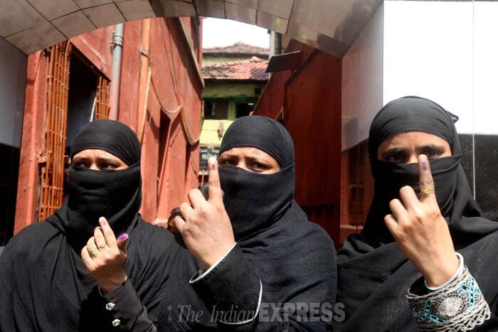 Muslim women show their ink-stained fingers after casting their vote in Kolkata. ( Source: Express photo by Partha Paul )