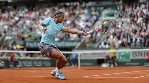 Rafael Nadal returns a forehand to Dominic Thiem of Austria during their men's singles match at the French Open on Thursday. Nadal won 6-2, 6-2, 6-3. (Source: Reuters)