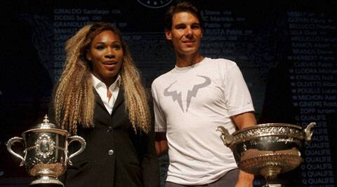 Defending champions Serena Williams and  Rafael Nadal pose during the draw for the French Open tournament in Paris on Friday. (Source: AP)