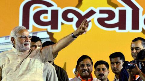 Narendra Modi flashes victory sign during a public rally at Ahmedabad. (PTI)