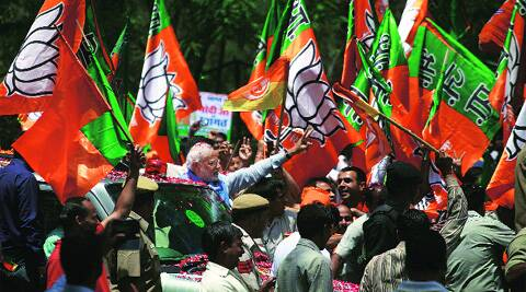 Supporters greet BJP's PM-designate Narendra Modi near 11 Murti on Saturday. Oinam Anand