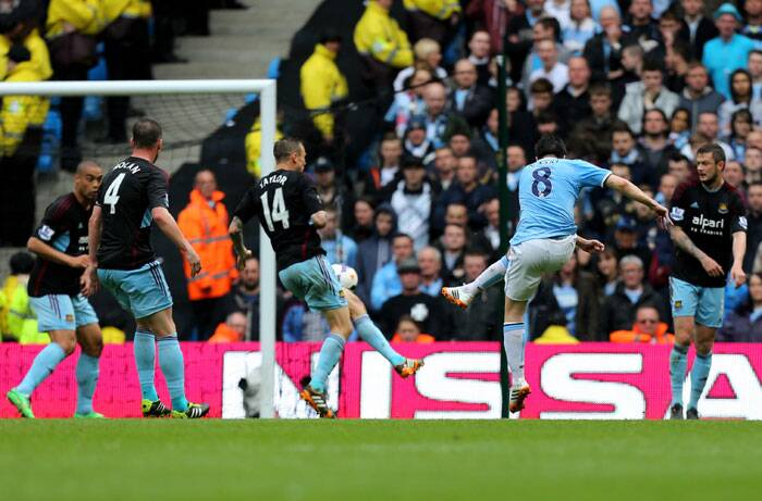 Nasri calmed City nerves with a fierce strike in the 39th minute (AP)