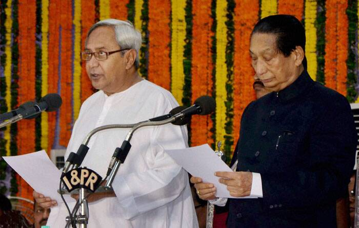 After steering the BJD to a landslide victory in Assembly elections, Naveen Patnaik on Wednesday took oath as Odisha Chief Minister for a record fourth consecutive term. <br />Naveen Patnaik is sworn-in as Chief Minister of Odisha by the Governor SC Jamir during a ceremony at Rajbhawan in Bhubaneswar on Wednesday. (Source: PTI)