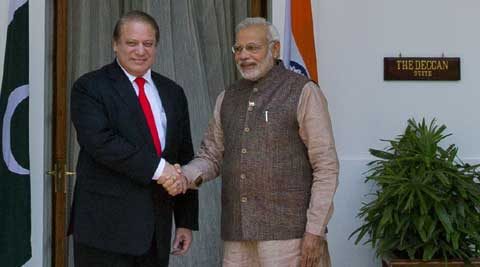 Prime Minister Narendra Modi shakes hand with his Pakistani counterpart Nawaz Sharif before the start of their meeting in New Delhi. (Source: AP)